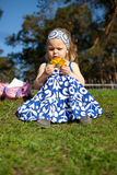 Merry beautiful girl sitting on green grass Royalty Free Stock Photo