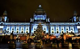 Merry Belfast City Hall. Spectacular Belfast City Hall and Christmas Market. Night, season decoration, light and unforgettable atmosphere before Christmas Stock Photo