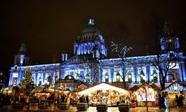 Merry Belfast City Hall. Spectacular Belfast City Hall and Christmas Market. Night, season decoration, light and unforgettable atmosphere before Christmas. Black Royalty Free Stock Images