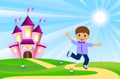 Merry boy and fairy-tale palace on a green lawn Royalty Free Stock Image