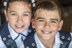 Merry boy and girl smiling at the camera. Portrait photography Stock Photography