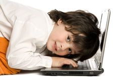 The merry boy with laptop on white background Stock Photo