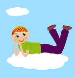 Merry boy lie on cloud Stock Photos