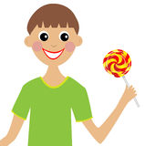 Merry boy  with lollipop in hand Royalty Free Stock Images
