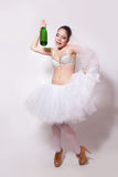 Merry bride with a bottle of champagne in hand Stock Photos