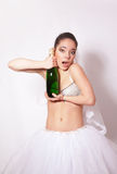 Merry bride with a bottle of champagne in hand Royalty Free Stock Images