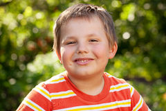Merry brown-eyed boy. Dressed in a striped t-shirt Stock Images