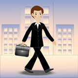 Merry business man walks along the street on work Stock Image