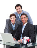 Merry business team working at a computer. Against a white background Royalty Free Stock Photo