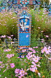 Merry Cemetery. The Merry Cemetery is a cemetery in the village of Săpânţa, Romania. It is famous for its colourful tombstones with naïve paintings royalty free stock photography