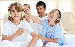 Merry children having fun and listening music Stock Photos