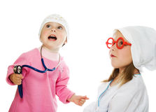 Merry children playing as doctor and patient Stock Photo