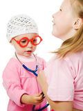 Merry children playing as doctor and patient Royalty Free Stock Images