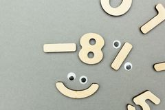 Merry children`s mathematics from wooden figures stock photos