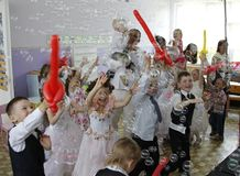 Merry children`s party with bubbles and balls stock images