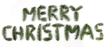 Merry christmas. Text made up from twigs of the spruce Royalty Free Stock Photos