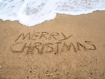 Merry Christmas. Written on the beach in the sand Stock Image