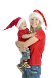 Merry Christmas!. Young attractive mommy and baby with Santa's hats Stock Photos