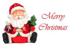 Merry Christmas. Toy Santa with red Merry Christmas text Stock Photo