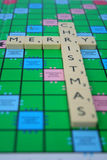 Merry christmas. Inscription made of scrabble tiles Royalty Free Stock Photo