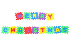 Merry Christmas. Message Merry Christmas from letter puzzle, isolated on white Royalty Free Stock Image