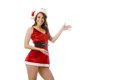 Merry christmas. Sexy lady in a short red santa outfit isolated on a white background gesturing with copy space to add your own content Stock Photo
