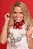 Merry Christmas. Beautiful young woman with some christmas balls royalty free stock photo