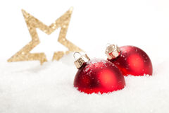 Merry Christmas. Christmas Baubles and a star with some snow - merry christmas everybody Royalty Free Stock Photo