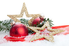 Merry Christmas. Christmas baubles, Stars and a branch in a landscape of snow - studio shot Stock Images