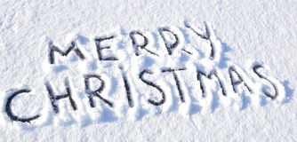 Merry Christmas. Greetings written on snow Royalty Free Stock Images