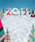 Merry christmas 2013. Logo 2013  with graphic snow paper trees and white background Royalty Free Stock Images