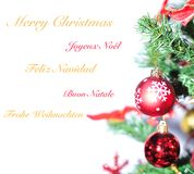 Merry Christmas. Merry Christmas in different languages Stock Image