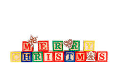 Merry Christmas. In colorful children's block letters  on white background Royalty Free Stock Images