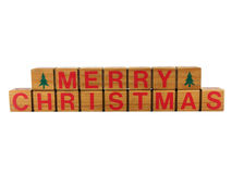 Merry Christmas. Photo of the words merry christmas spelled out on wooden blocks, isolated on white Royalty Free Stock Photos
