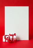 Merry Christmas. Two wrapped gifts represent christmas theme, with a blank white card for text Stock Image