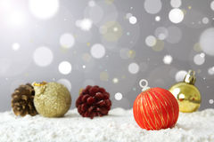Merry Christmas. Christmas decoration ball on snow against lights background Stock Photography
