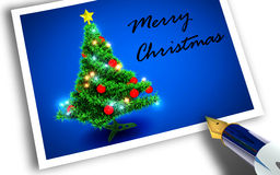Merry Christmas. Photograph of Christmas tree on blue background Royalty Free Stock Photos