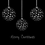 Merry Christmas. Black christmas card with 3 balls Royalty Free Stock Photography