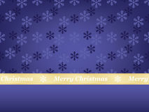 Merry Christmas. Blue snowflakes background with Merry Christmas ribbon Royalty Free Stock Image