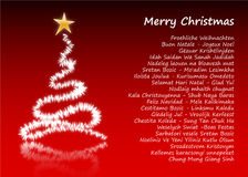 Merry Christmas in 31 different languages. Merry Christmas postcard in 31 different languages, with  Christmas tree Stock Photo