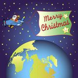 Merry christmas. Santa claus is flying in space passing the earth Royalty Free Stock Images
