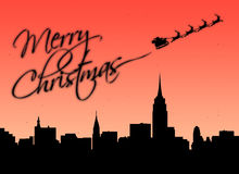 Merry Christmas. Santa writing merry christmas in glitters with his sled over the New York skyline stock illustration