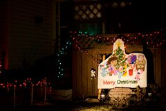 Merry Christmas. A festive sign decorates a house during the holiday season stock image
