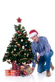 Merry Christmas. Christmas tree and man with Santa hat on white background Royalty Free Stock Photography