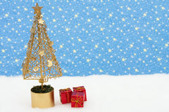 Merry Christmas. Christmas tree snow with presents on star background, merry Christmas Royalty Free Stock Photos