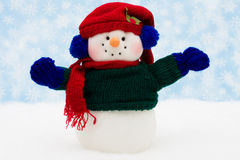Merry Christmas. Snowman on snow with snowflake background, merry Christmas Stock Images