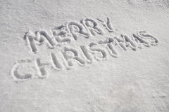 Merry Christmas. The words Merry Christmas written in the snow Royalty Free Stock Images
