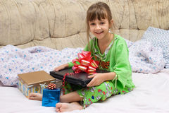 Merry Christmas. The little girl with Christmas gifts Royalty Free Stock Image