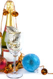 Merry Christmas. There are Christmas decorations and bottle of champagne, isolated on the white background Royalty Free Stock Photo