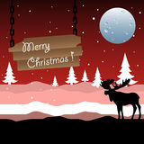 Merry Christmas. Abstract colorful background with a moose silhouette, full moon, fir trees and a wooden plate with the text Merry Christmas hanging in chains Stock Image